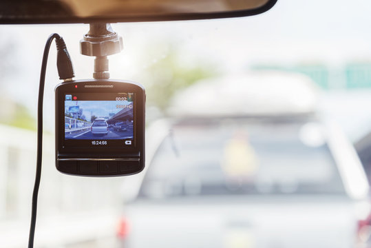Recorder camera in front of car for safety on the road.