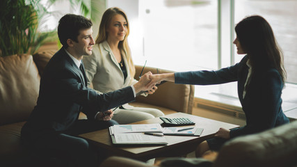 Handshake of business partners after discussing a new financial contract