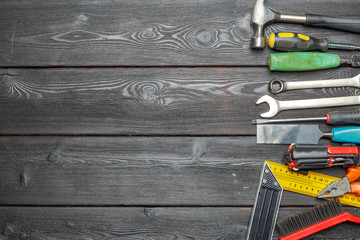Assorted work tools on wooden table