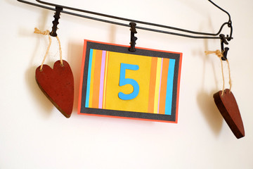 Number 5 anniversary celebration card against a bright white background