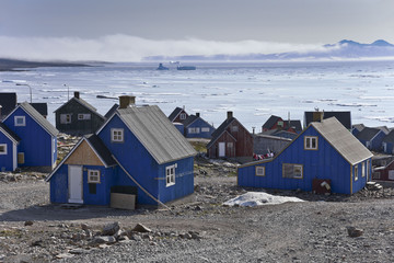 blue houses in itoqqortoomiit in east greenland