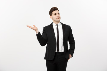 Business Concept: Attractive handsome business man shows hand on side. Copy space on white background