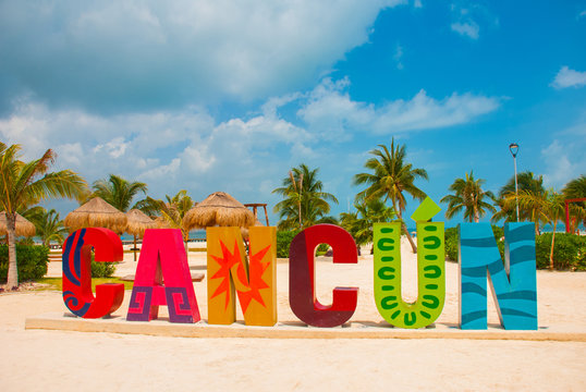 Cancun, Mexico, inscription in front of the Playa Delfines beach. Huge letters of the city name.