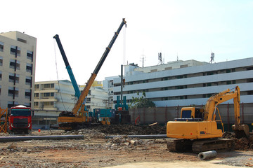 city and landscape,construction machinery,excavator and crane in working site area,project building hospital construction for health services in urban and worker