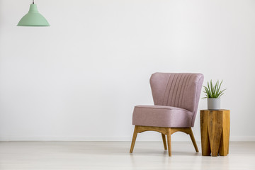 Retro chair in empty room