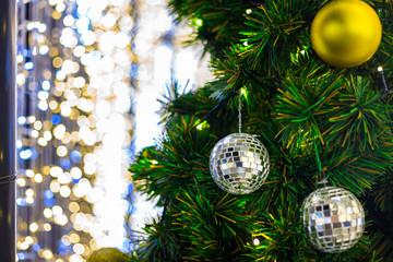 Closeup of Colorful light Abstract circular bokeh Green Christmas tree background.
