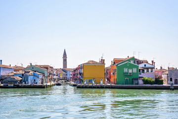 Daylight view from Venetian Lagoon to vibrant colorful buildings
