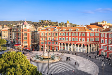 Photo sur Plexiglas Nice Aerial view of Place Massena square with red buildings and fountain in Nice, France