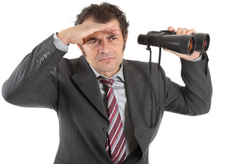 A middle-aged businessman looking through binoculars, isolated on white background