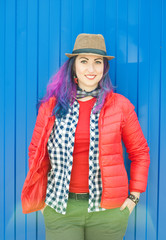 Happy beautiful fashion hipster woman with colorful hair