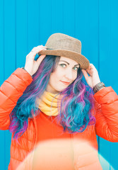 Fashion hipster woman with colorful hair having fun