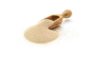 Active dry yeast in wooden scoop