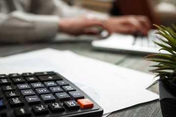 Business man calculate about cost and doing finance at office finance managers task concept