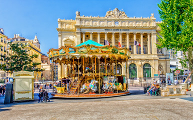 "One of Marseille square with a merry-go-round and the ""Palais de la Bourse"" building in spring 2017"