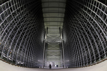 A worker stands between the steel frames of a high rise warehouse of metal distributor Debrunner Acifer AG currently under construction in Birsfelden