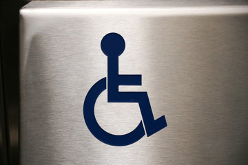Disabled sign stainless blue in elevator symbol wheelchair background