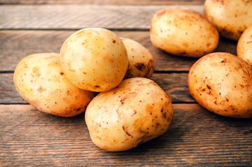heap of raw potato roots