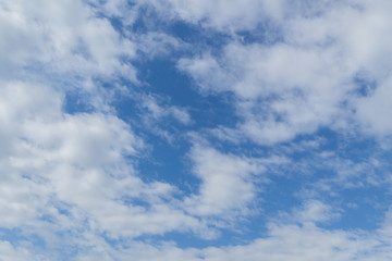 Blue sky background with clouds. White clouds on blue sky. Blue sky with clouds closeup. Natural background
