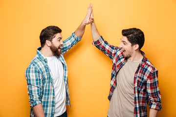 Portrait of a two happy young men giving high five Fototapete