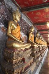 Close up golden buddha statues in Wat Suthat Thepwararam,Bangkok Thailand