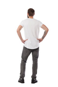 Isolated hipster man looking up. Backwords to a viewer