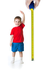 Kid growing measuring with ruler