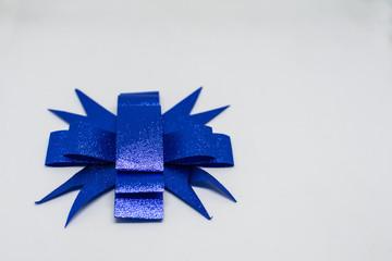 Blue ribbon on a beautiful white background.