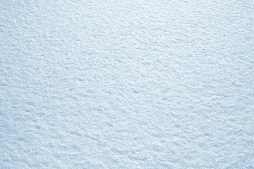 Fresh snow background texture. Winter background with snowflakes and snow mounds.