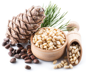Pine nut cone and pine nuts on the white background. Organic food.
