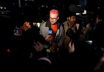 Whistleblower Christopher Wylie speaks to journalists at a protest opposite Parliament in London