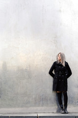 Young woman standing in futuristic minimal environment