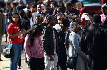 Mourners wait to enter the funeral of police shooting victim Stephon Clark, in Sacramento
