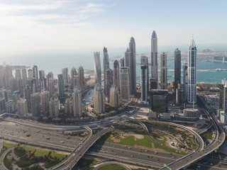 Aerial view of skyscrapers and sea in the background in Dubai.