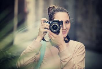 woman taking snapshots