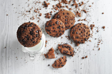chocolate oatmeal cookies on a white background with milk