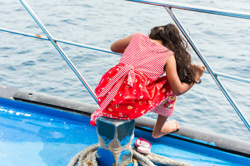 Girl in a deck boat dress, Male, Maldives. Copy space for text. Back view.