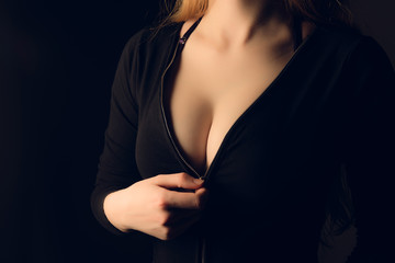 Sexy woman tits in black jacket.