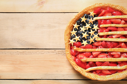 Tasty American flag pie on wooden background