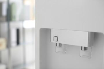 Modern water cooler indoors, closeup
