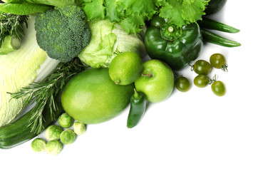 Green vegetables and fruits on white background. Food photography