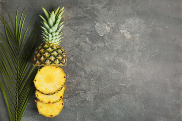 Cut fresh pineapple on grey background