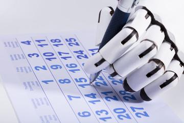 Fototapete - Robot Marking Date On Calendar
