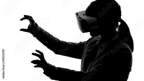 Silhouette of woman in vr headset playing martial arts game
