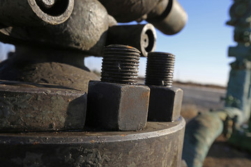 The bolts and nuts on the industrial equipment