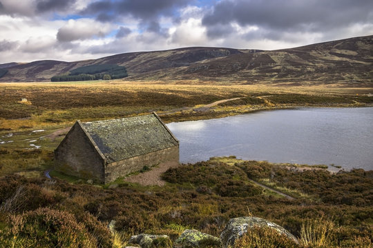 Boat house at Loch Muick, Ballater, Scotland, UK. Royal Deeside and Cairngorm Mountains, one of the most beautiful parts of Scotland. October 2017