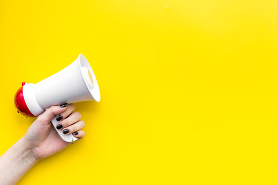 Megaphone make an announcement on yellow background top view copy space