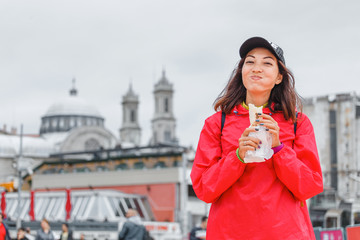 Young woman eating turkish fast food in Istanbul, Turkey