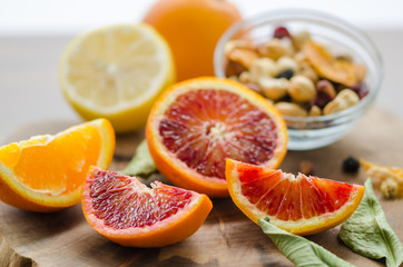 Sliced oranges  on the wooden table. Citrus sinensis orange,lemon and nuts, Wall mural