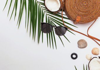 Feminine accessories, greem leaves and half of the coconut.