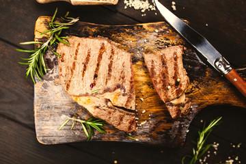 Grilled steak on wooden cutting board